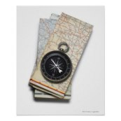 a_compass_sitting_on_a_stack_of_folded_road_maps_poster-r05bc98e42727495a8076928590ff9fbb_wvc_8byvr_324
